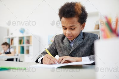 African boy studying at school
