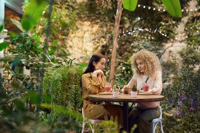 Two friends have a meeting in cafe