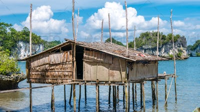 Local Bamboo Hut in Kabui Bay near Waigeo. West Papuan, Raja Ampat, Indonesia