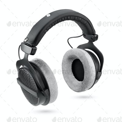 Black studio headphones isolated on white background