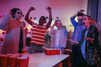 Excited people playing at the party