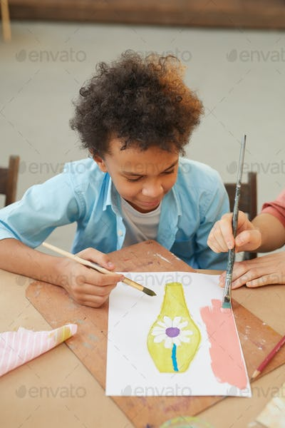 Boy painting a picture