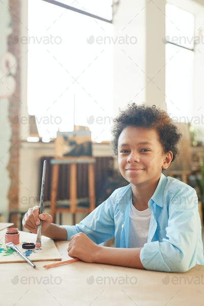 Boy sitting at art lesson