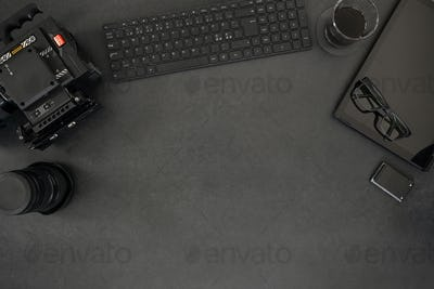 Directly above shot of computer and photographic equipment on table
