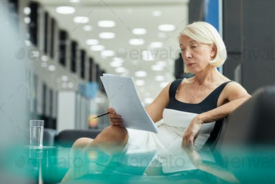 Businesswoman examining contract