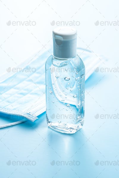 Coronavirus prevention hand sanitizer gel and protection face mask.