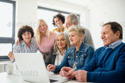 Group of senior people attending computer and technology education class