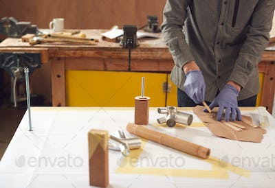 Close Up Of Male Craftsman In Workshop Assembling Hand Built Sustainable Bamboo Bicycle Frame