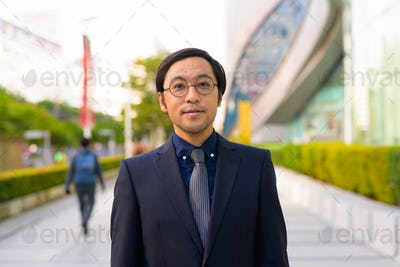 Asian businessman with nature in the city outdoors