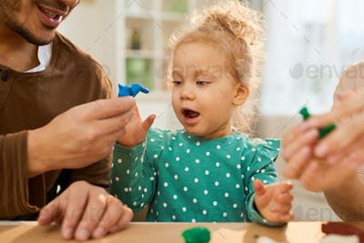 Showing Play Dough Model To Child