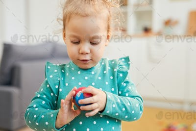 Girl With Modelling Clay Ball