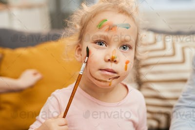 Child Painting On Face