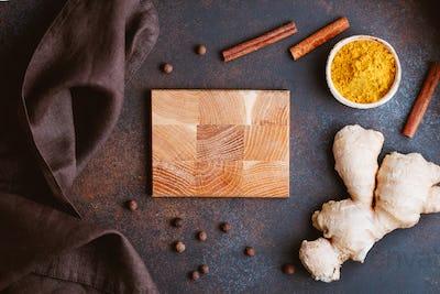 Ingredients for preparation turmeric latte. Curcuma, ginger, cinnamon and allspice.