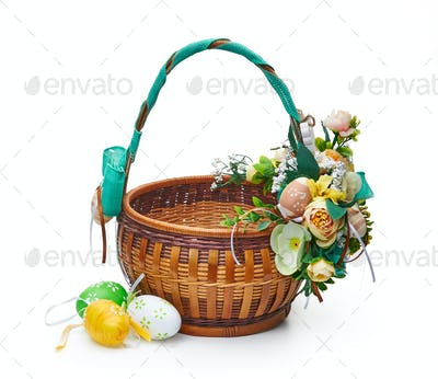 Easter basket from a flower arrangement on white background