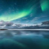 Northern lights on Lofoten islands, Norway. Winter landscape
