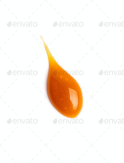 sweet caramel sauce drop isolated on white
