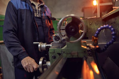 Man working on lathe