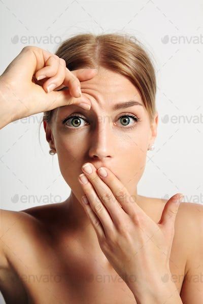 beauty girl wondering her first wrinkle
