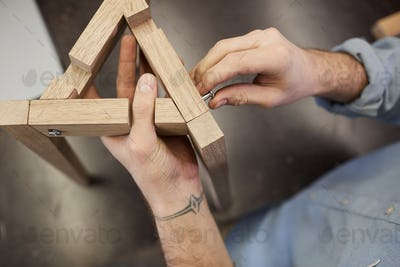 Man making wooden figure