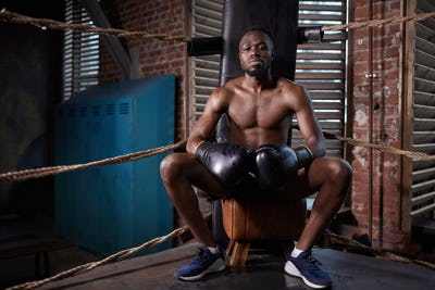 African professional boxer on boxing ring