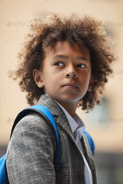 African schoolboy with backpack