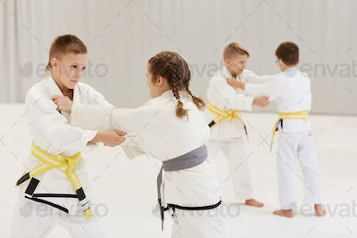 Children practicing karate at competition