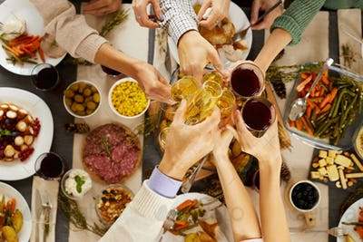 People toasting at the table