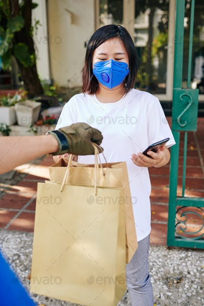 Young woman receiving paper bags