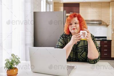 Woman reading news online