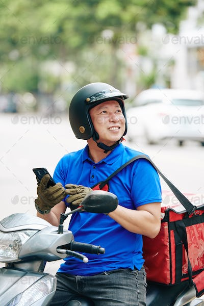 Courier checking address of client