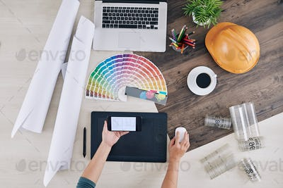Interior designer checking house blueprint