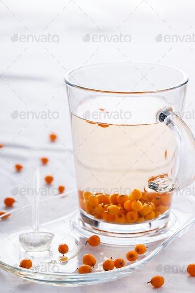 Tea with sea buckthorn and honey.Vitamin drink for immunity against the virus.