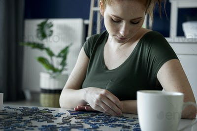 Bored woman over a puzzle game