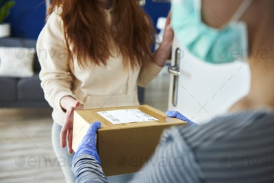 Detail of parcel delivery at home