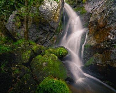 Waterfall jumps between granite walls