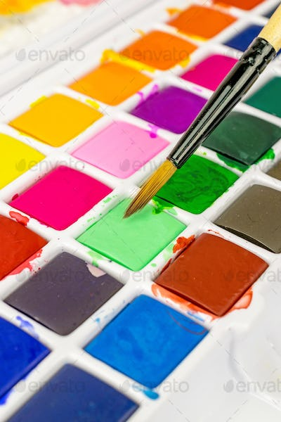 An Artists Paint Brush and Pallet