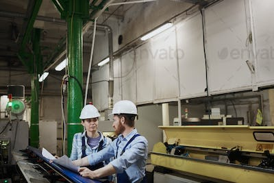Two engineers working in the plant
