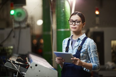 Female worker working in the plant