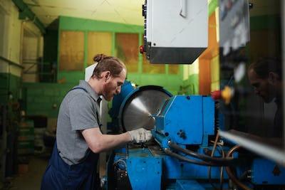 Mechanic repairing the lathe