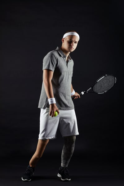 Paralympic sportsman playing tennis