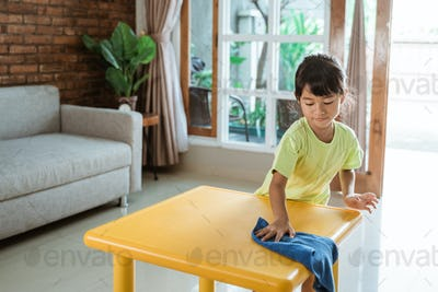 little kid cleaning up the table