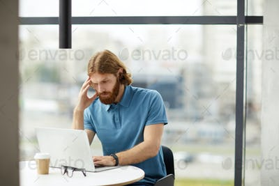 Businessman working on laptop at office
