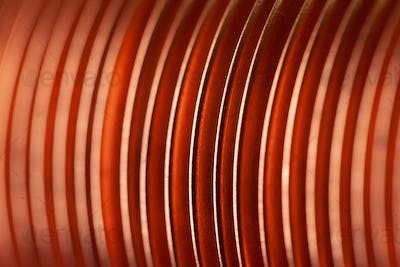 Close-up flat copper twisted plates at the factory