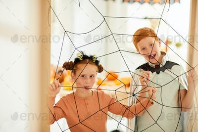 Children playing in spiders