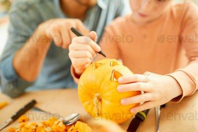 Making Jack O' Lantern for Halloween