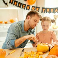 Family preparing pumkins for holiday