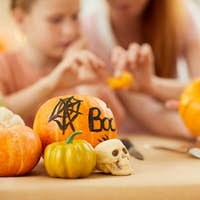 Pumpkins are on the table for Halloween