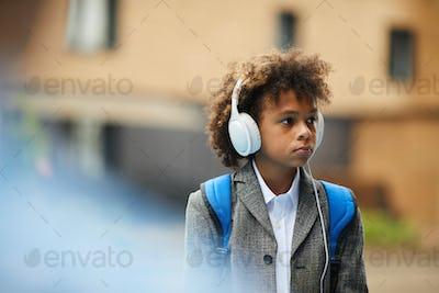 African schoolboy going to school