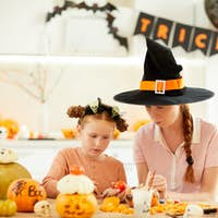 Mother with daughter celebrating Halloween