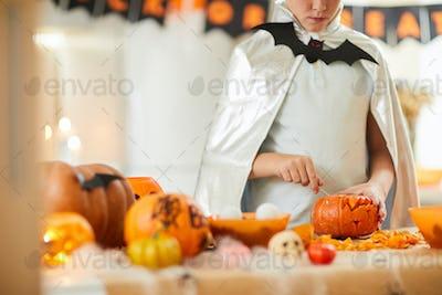 Boy carving pumpkin